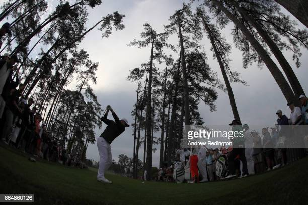 Rory McIlroy of Northern Ireland plays his shot from the 17th tee during a practice round prior to the start of the 2017 Masters Tournament at...