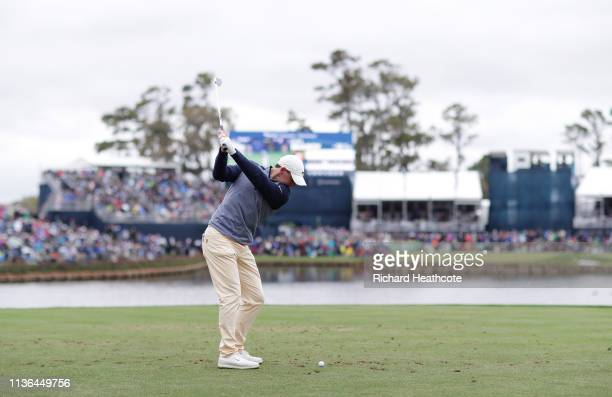 Rory McIlroy of Northern Ireland plays his shot from the 17th tee during the final round of The PLAYERS Championship on The Stadium Course at TPC...
