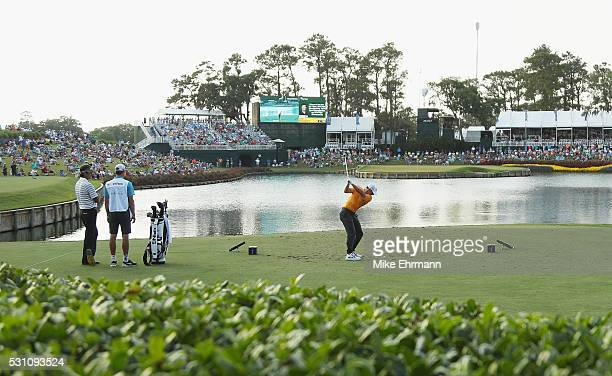 Rory McIlroy of Northern Ireland plays his shot from the 17th tee during the first round of THE PLAYERS Championship at the Stadium course at TPC...