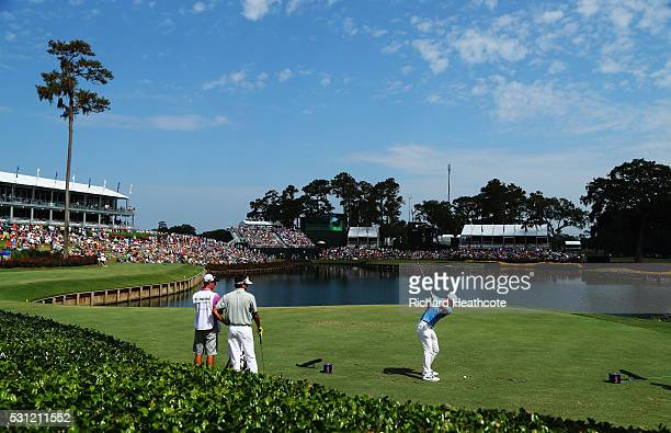 Rory McIlroy of Northern Ireland plays his shot from the 17th tee during the second round of THE PLAYERS Championship at the Stadium course at TPC...
