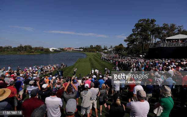 Rory McIlroy of Northern Ireland plays his shot from the 18th tee during the first round of The PLAYERS Championship on The Stadium Course at TPC...