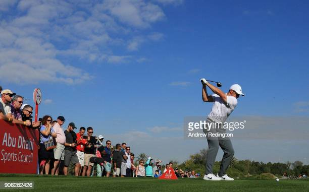 Rory McIlroy of Northern Ireland plays his shot from the 18th tee during round one of the Abu Dhabi HSBC Golf Championship at Abu Dhabi Golf Club on...