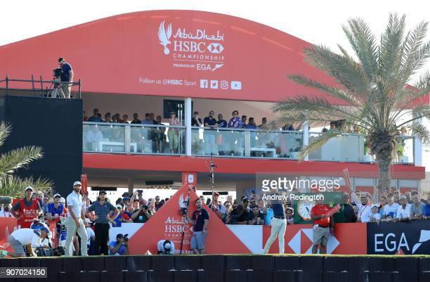 Rory McIlroy of Northern Ireland plays his shot from the 18th tee during round two of the Abu Dhabi HSBC Golf Championship at Abu Dhabi Golf Club on...
