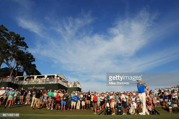 Rory McIlroy of Northern Ireland plays his shot from the 18th tee during the second round of THE PLAYERS Championship on the Stadium Course at TPC...