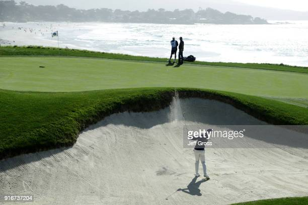 Rory McIlroy of Northern Ireland plays his shot from the bunker on the ninth hole during Round Three of the ATT Pebble Beach ProAm at Pebble Beach...