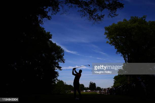 Rory McIlroy of Northern Ireland plays his shot from the eighth tee during the final round of the RBC Canadian Open at Hamilton Golf and Country Club...