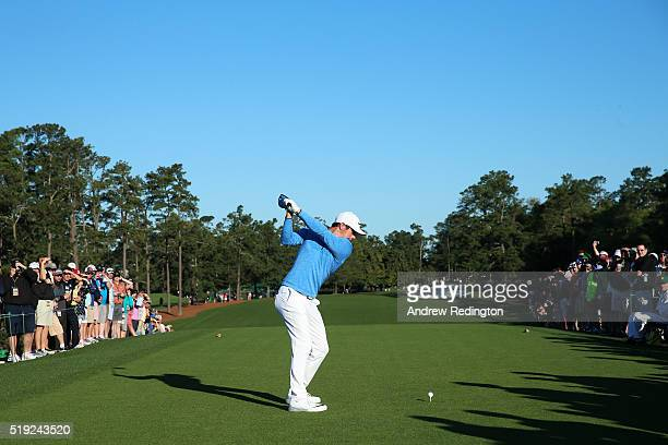 Rory McIlroy of Northern Ireland plays his shot from the first tee during a practice round prior to the start of the 2016 Masters Tournament at...