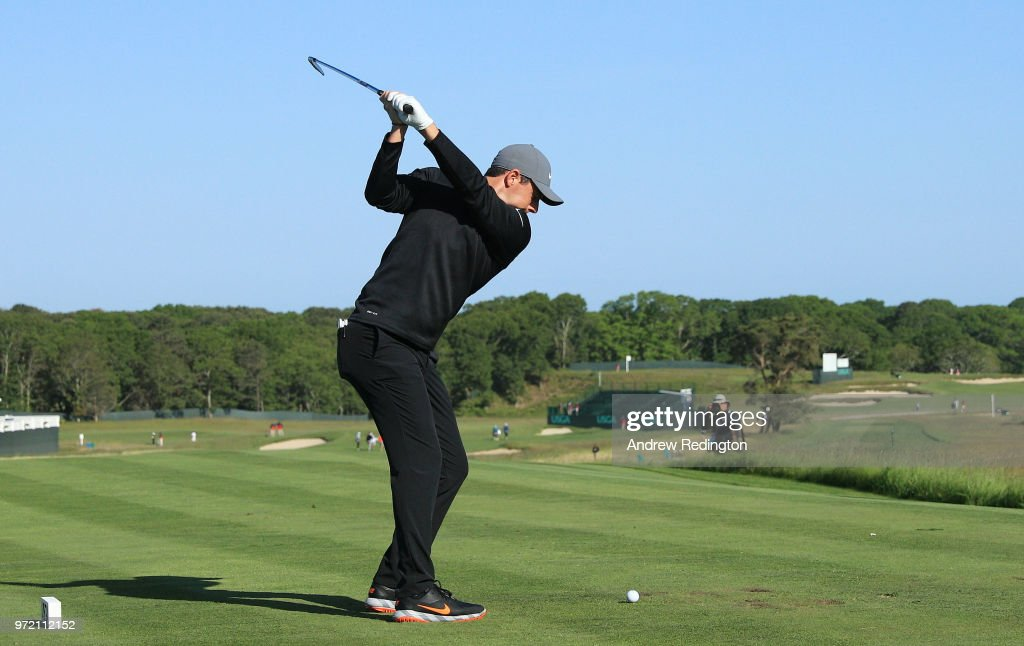 Rory McIlroy of Northern Ireland plays his shot from the first tee during a practice round prior to the 2018 U.S. Open at Shinnecock Hills Golf Club on June 12, 2018 in Southampton, New York.