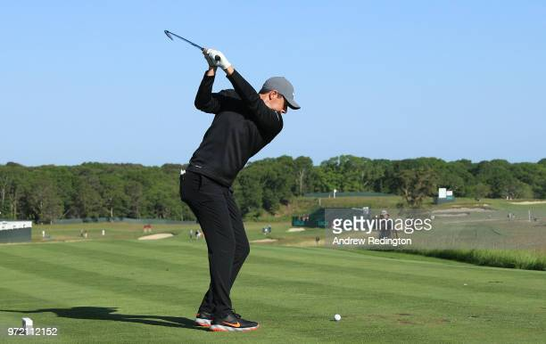 Rory McIlroy of Northern Ireland plays his shot from the first tee during a practice round prior to the 2018 U.S. Open at Shinnecock Hills Golf Club...