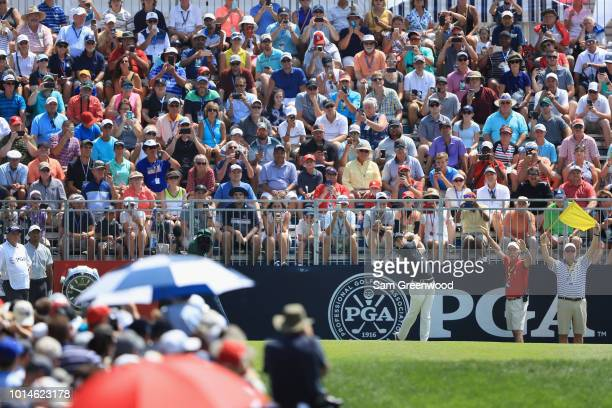 Rory McIlroy of Northern Ireland plays his shot from the first tee during the second round of the 2018 PGA Championship at Bellerive Country Club on...