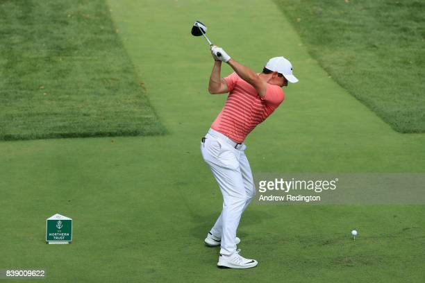 Rory McIlroy of Northern Ireland plays his shot from the first tee during round two of The Northern Trust at Glen Oaks Club on August 25 2017 in...