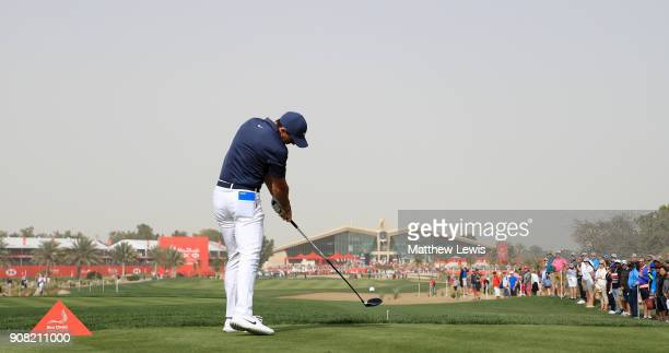 Rory McIlroy of Northern Ireland plays his shot from the ninth tee during the final round of the Abu Dhabi HSBC Golf Championship at Abu Dhabi Golf...
