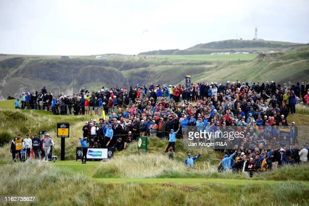 Rory McIlroy of Northern Ireland plays his shot from the seventh tee during the first round of the 148th Open Championship held on the Dunluce Links...