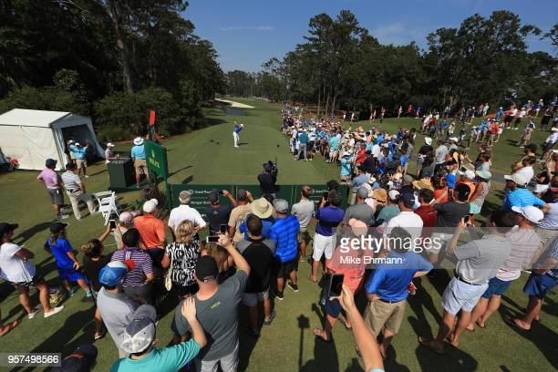 Rory McIlroy of Northern Ireland plays his shot from the tenth tee during the second round of THE PLAYERS Championship on the Stadium Course at TPC...