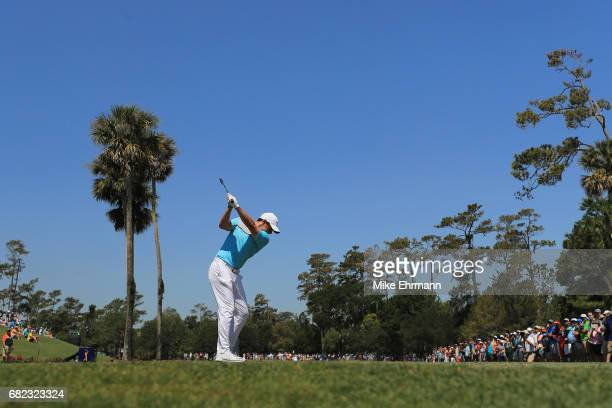 Rory McIlroy of Northern Ireland plays his shot from the third tee during the second round of THE PLAYERS Championship at the Stadium course at TPC...