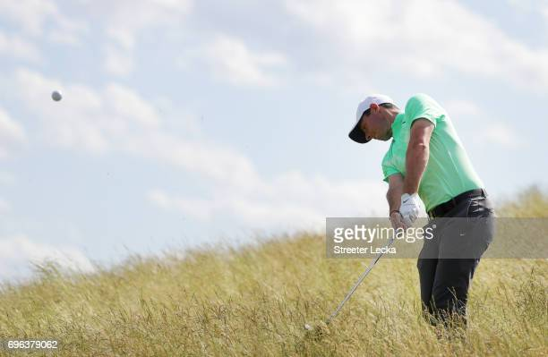 Rory McIlroy of Northern Ireland plays his shot on the eighth hole during the first round of the 2017 US Open at Erin Hills on June 15 2017 in...