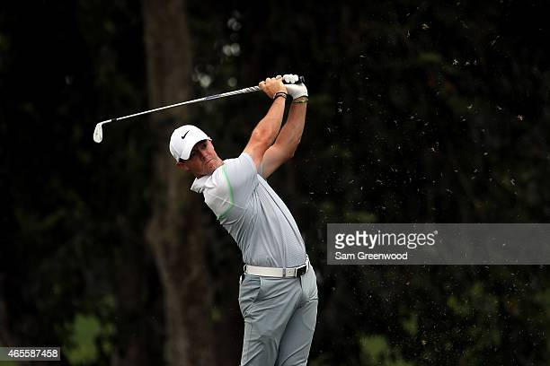 Rory McIlroy of Northern Ireland plays his shot on the second hole during the final round of the World Golf ChampionshipsCadillac Championship at...