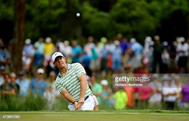 Rory McIlroy of Northern Ireland plays his shot onto the seventh green during round two of THE PLAYERS Championship at the TPC Sawgrass Stadium...