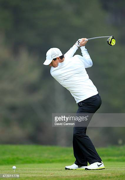 Rory McIlroy of Northern Ireland plays his tee shot at the par 4 12th hole during his quarter final match in the World Golf Championships Cadillac...