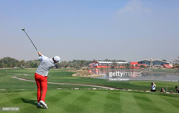 Rory McIlroy of Northern Ireland plays his tee shot at the par 5 18th hole during the completion of the fog delayed second round of the 2016 Abu...