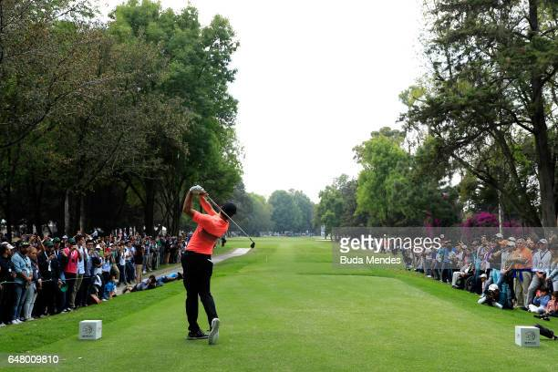 Rory McIlroy of Northern Ireland plays his tee shot on the ninth hole during the third round of the World Golf Championships Mexico Championship at...