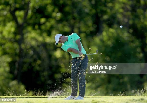 Rory McIlroy of Northern Ireland plays his tee shot on the par 3 16th hole during the first round of the 117th US Open Championship at Erin Hills on...