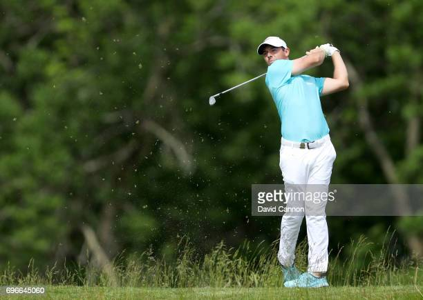 Rory McIlroy of Northern Ireland plays his tee shot on the par 3 16th hole during the second round of the 117th US Open Championship at Erin Hills on...