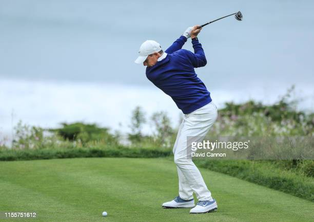 Rory McIlroy of Northern Ireland plays his tee shot on the par 4 11th hole during the first round of the 2019 USOpen at the Pebble Beach Golf Links...