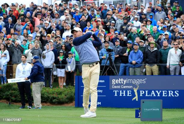 Rory McIlroy of Northern Ireland plays his tee shot on the par 4, 18th hole during the final round of The Players Championship on the Stadium Course...