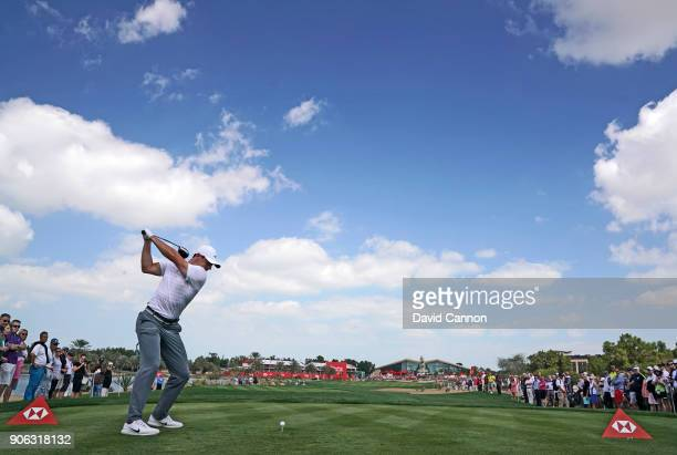 Rory McIlroy of Northern Ireland plays his tee shot on the par 4 ninth hole during the first round of the 2018 Abu Dhabi HSBC Golf Championship at...