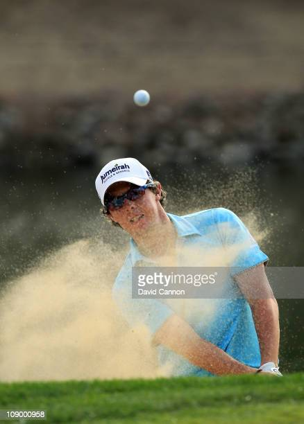 Rory McIlroy of Northern Ireland plays his third shot at the par 5 13th hole during the second round of the 2011 Omega Dubai Desert Classic on the...