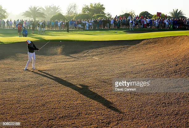Rory McIlroy of Northern Ireland plays his third shot at the par 5, 10th hole during the first round of the 2016 Abu Dhabi HSBC Golf Championship at...