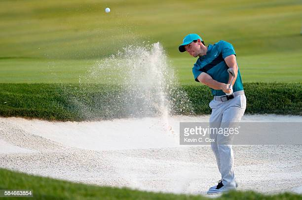 Rory McIlroy of Northern Ireland plays his third shot from a bunker on the 17th hole during the second round of the 2016 PGA Championship at...