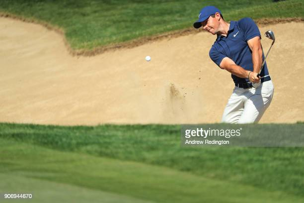 Rory McIlroy of Northern Ireland plays his third shot from a bunker on the second hole during round two of the Abu Dhabi HSBC Golf Championship at...