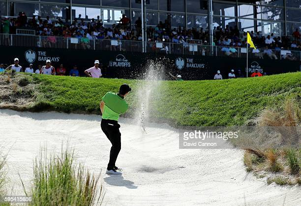Rory McIlroy of Northern Ireland plays his third shot on the 18th hole during the first round of The Barclays in the PGA Tour FedExCup PlayOffs on...
