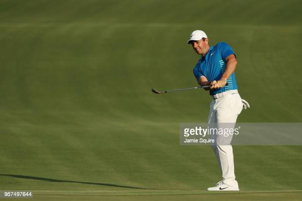 Rory McIlroy of Northern Ireland plays his third shot on the 18th hole during the second round of THE PLAYERS Championship on the Stadium Course at...