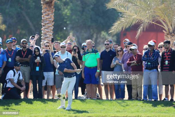 Rory McIlroy of Northern Ireland plays his third shot on the eighth hole during round two of the Abu Dhabi HSBC Golf Championship at Abu Dhabi Golf...