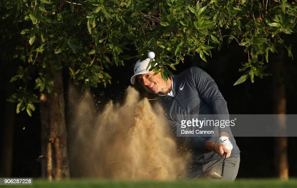 Rory McIlroy of Northern Ireland plays his third shot on the par 5 10th hole during the first round of the 2018 Abu Dhabi HSBC Gof Championship at...