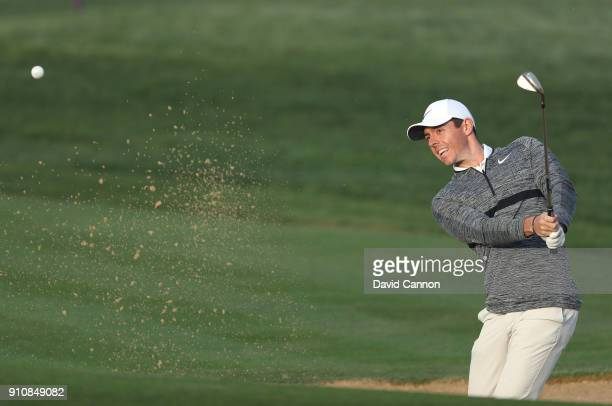 Rory McIlroy of Northern Ireland plays his third shot on the par 5, 13th hole during the completion of the second round of the Omega Dubai Desert...