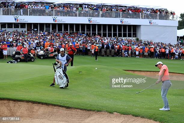 Rory McIlroy of Northern Ireland plays his third shot on the third playoff hole against Graeme Storm of England during the final round of the 2017...