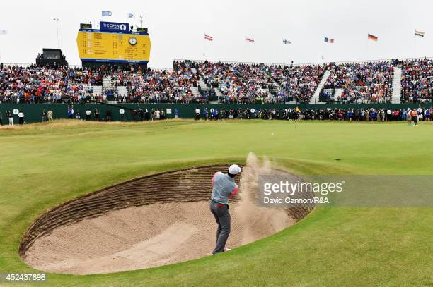 Rory McIlroy of Northern Ireland plays his third shot out of the bunker on the 18th hole during the final round of The 143rd Open Championship at...