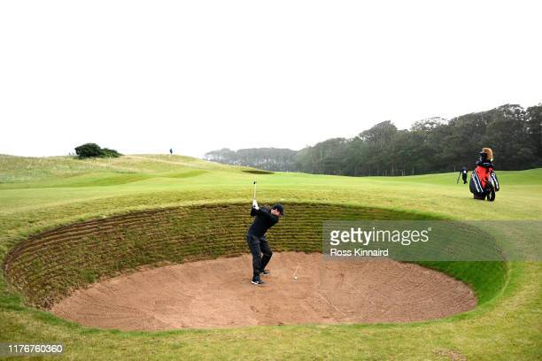 Rory McIlroy of Northern Ireland plays out of a bunker during previews for the Alfred Dunhill Links Championship at Kingsbarns on September 24, 2019...