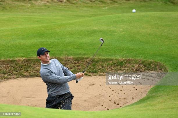 Rory McIlroy of Northern Ireland plays out of a bunker on the 15th green during the second round of the 148th Open Championship held on the Dunluce...