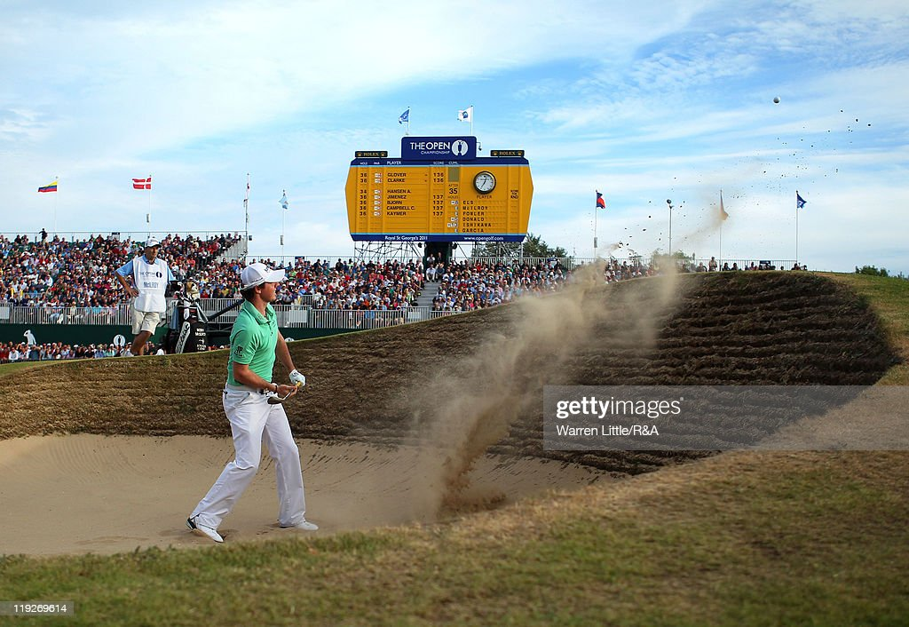 Rory McIlroy of Northern Ireland plays out of the greenside bunker on the 18th hole during the second round of The 140th Open Championship at Royal St George's on July 15, 2011 in Sandwich, England.
