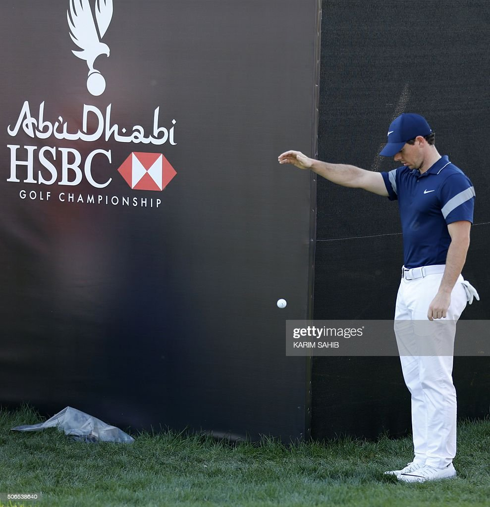 Rory McIlroy of Northern Ireland plays with a ball during the final of the Abu Dhabi Golf Championship in the capital of the United Arab Emirates on January 24, 2016. / AFP / KARIM