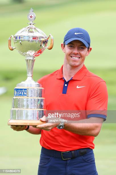 Rory McIlroy of Northern Ireland poses for a photo with the trophy after winning the RBC Canadian Open at Hamilton Golf and Country Club on June 09,...