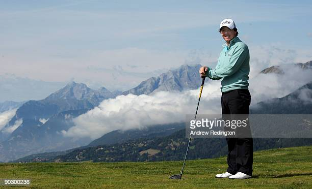 Rory McIlroy of Northern Ireland poses for a photograph in front of the mountains by the 7th hole during the Pro Am prior to the start of The Omega...