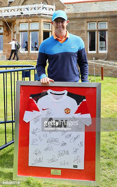 Rory McIlroy of Northern Ireland poses with a signed Manchester United during previews ahead of the 145th Open Championship at Royal Troon on July 12...