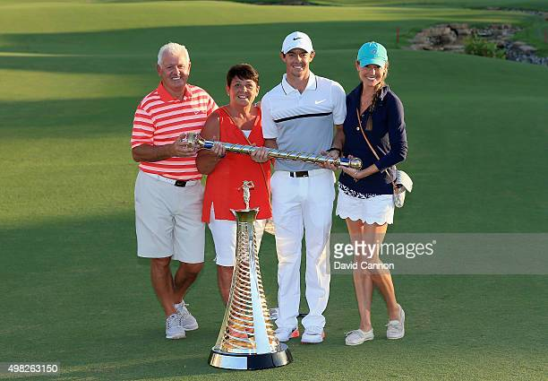 Rory McIlroy of Northern Ireland poses with his father Gerry McIlroy his mother Rosie McIlroy his girlfriend Erica Stoll and the DP World Tour...
