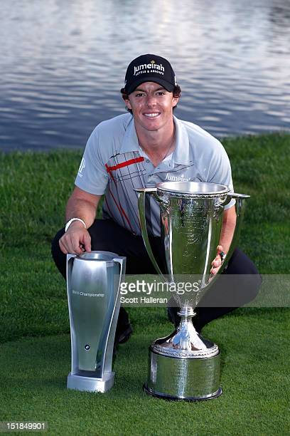 Rory McIlroy of Northern Ireland poses with J.K. Wadley Trophy and the BMW Championship Trophy after his victory at the BMW Championship at Crooked...